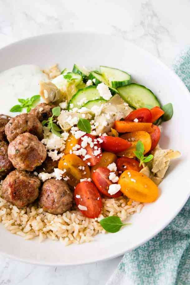 These Greek chicken meatball bowls are a quick weeknight dinner bursting with Mediterranean flavours of lemon, garlic and oregano. The whole dinner is on the table in 30 minutes.