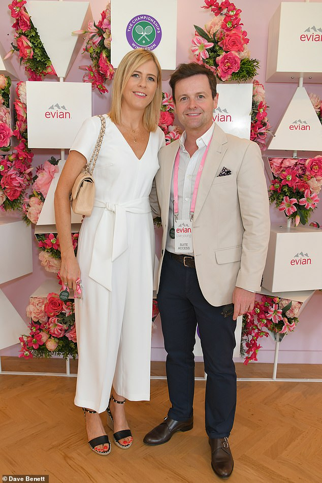 Mr Donnelly, 45 - one half of presenting duo Ant and Dec - his wife Ali, 43, (pictured together) and their two-year-old daughter Isla were all asleep upstairs in the seven-bedroom home