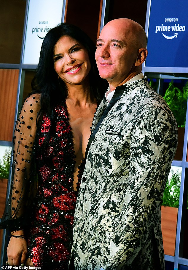 Bezos, pictured with girlfriend Lauren Sanchez, is stepping down as CEO later this year