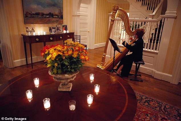 A military harpist plays music during a Thanksgiving dinner hosted by the Bidens in 2010