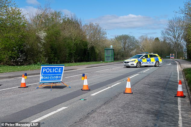 McArthur's 'on-off boyfriend' Christopher Minards, 35, an ex-Army medic, was charged with her murder. Pictured: Police block the road at the junction where Emma McArthur's body was found