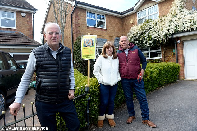 The move has prompted outrage from neighbours who say plans to flatten the house will change the 'way of life' in their leafy cul-de-sac. Pictured: Residents Rob Lee with Vaughan and Alison Williams