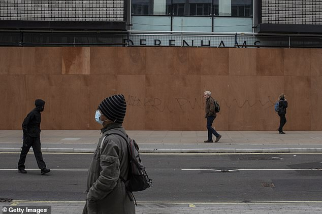 Members of the public walk past the closed Debenhams department store on Oxford Street in Londonyesterday