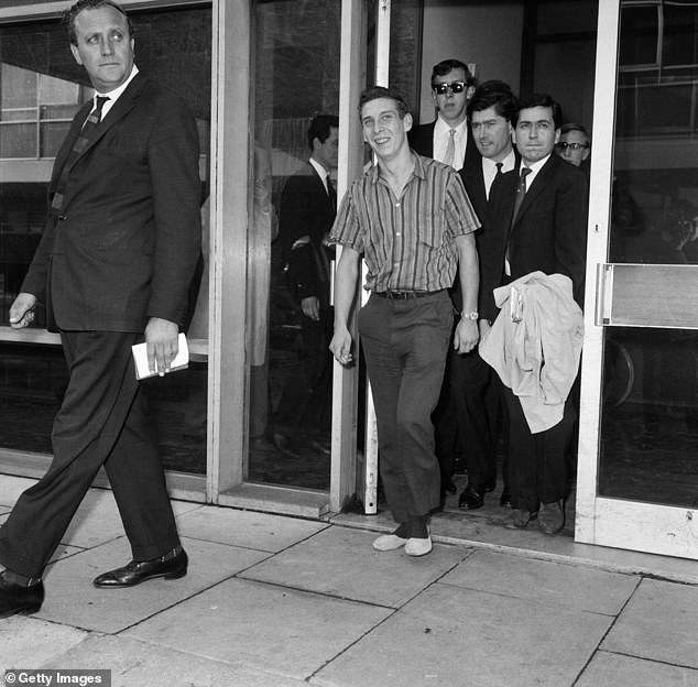 Stiff and limping, home-sick Welshman Brian Robson, 19, who tried to send himself back to Cardiff from Australia is pictured arriving at London Airport after his 96 hours in a crate