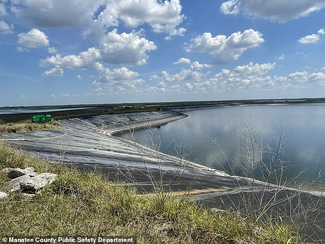 This image shows the breach in the containment wall of the Piney Point reservoir. This 77-acre pond was holding 480 million gallons of water just 2 weeks ago. Now it's below 300 million gallons as emergency drainage efforts continue