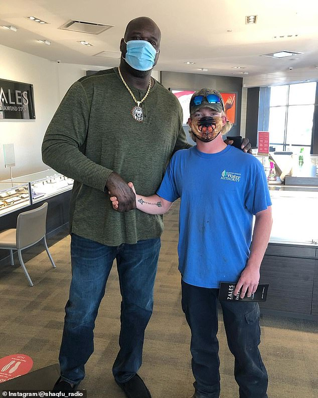 Shaq poses with a lucky stranger whose engagement ring he helped pay for at an Atlanta jewelry store
