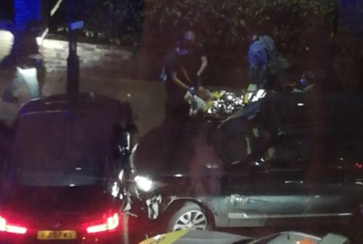 A man was stretchered into an ambulance after the crash in west London yesterday
