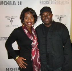 Erika Salter poses with Holla II director, H.M. Coakley at the film's Atlanta premiere.