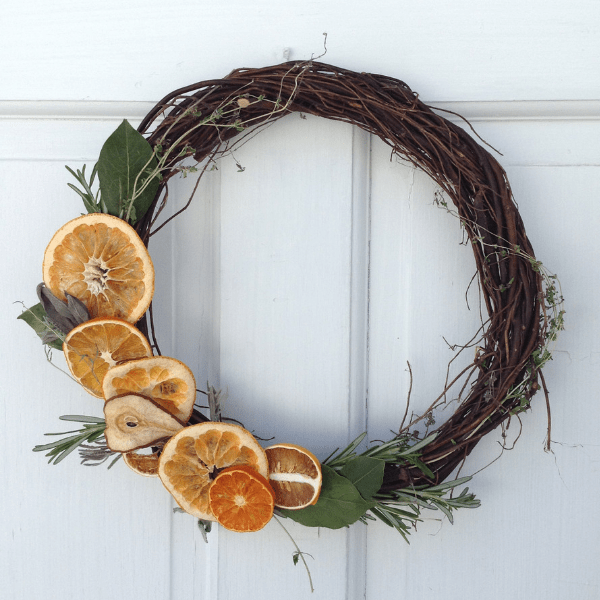 how to make a dried fruit and herb wreath #Christmascrafts #naturaldecorating #traditionalChristmas #farmhouseChristmas #farmhouseporch