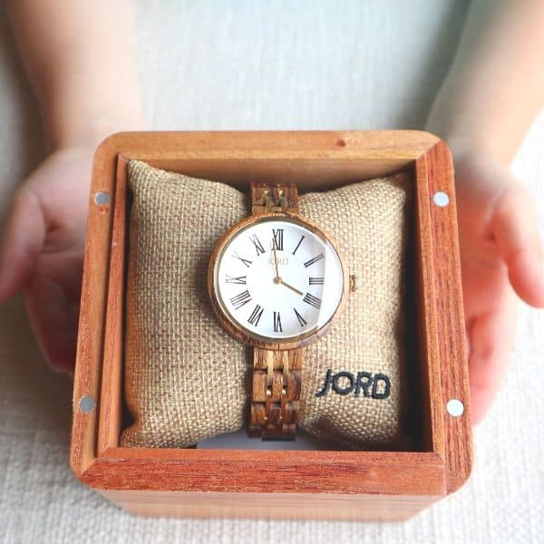 wooden watch being held by child