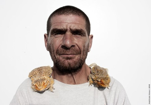 man-with-two-lizards
