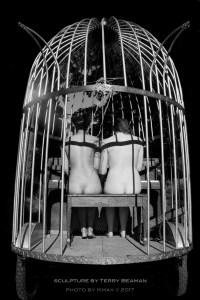 nude duet in bird cage