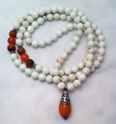 magnesite mala necklace with amber amulet