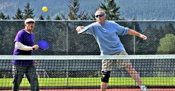 Pickleball rally on the court :: Salt Spring Island Pickleball Association