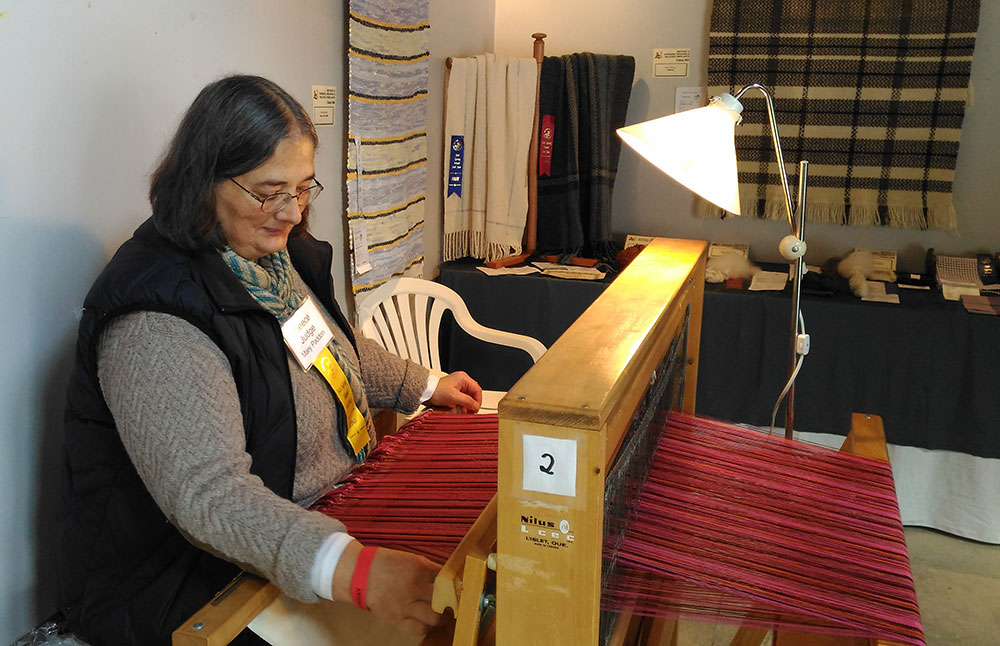 Salt Spring Island Weavers and Spinners Guild member demonstrates weaving.