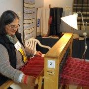 Salt Spring Island Weavers and Spinners Guild member demonstrates weaving.