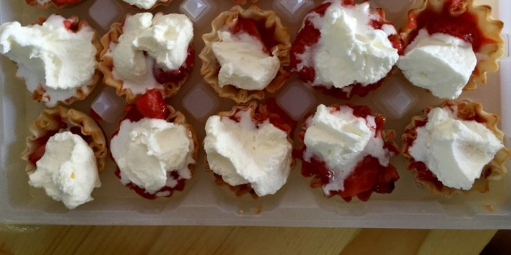 Mini strawberry pies with whipped cream