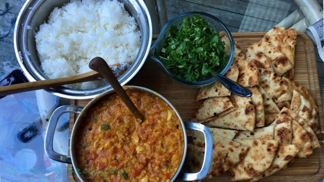 Autumn Gold Dal with turmeric, cilantro, naan, and jasmine rice