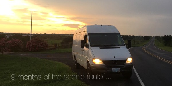 Converted Sprinter van on the road with sunset