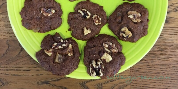 Ginger Molasses Walnut Cookies cooling on a plate
