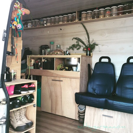 Van Conversion View Inside With Bus Seats Facing Sideways Dry Goods Floating Shelf Jars