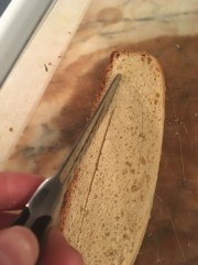 3) Using a knife, cut a square out of the center of your slice of bread