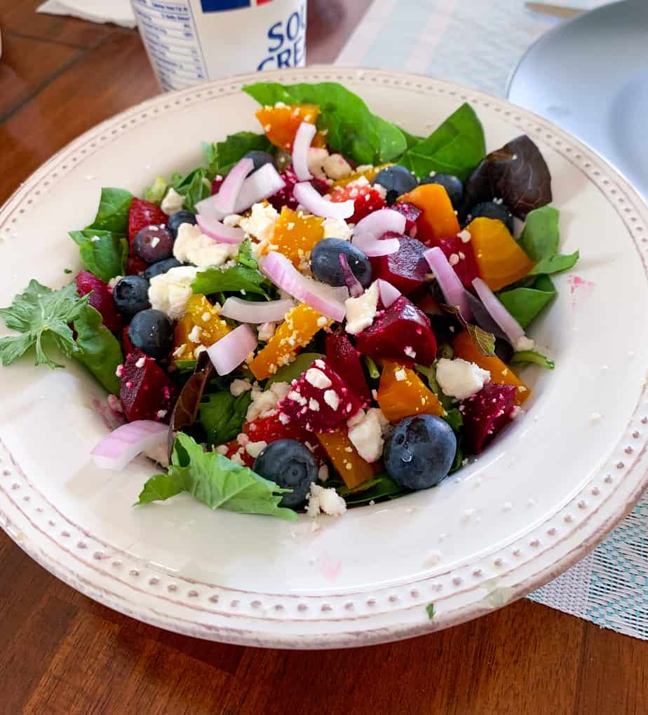 salad in a white bowl on a wooden table