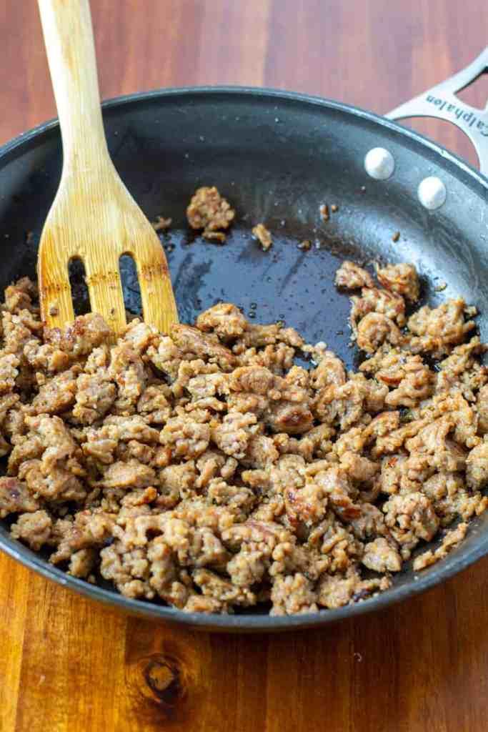 sautéd sausage in a pan