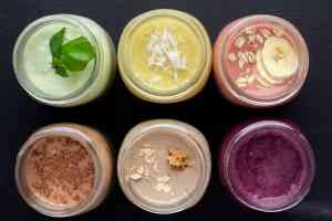 6 smoothies on a black background