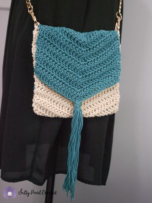 A Boho Chevron Crochet Purse Displayed on a mannequin.