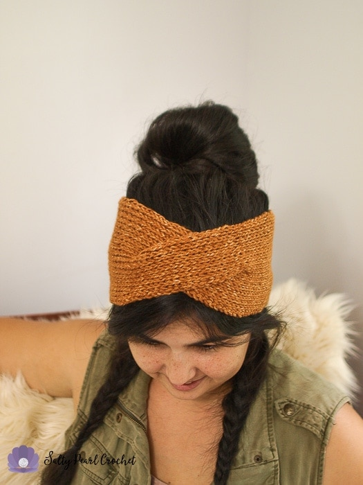 A close shot of the twisted boho crochet headwrap pattern sample