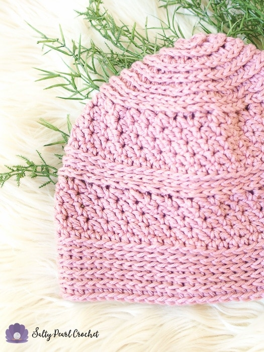 Closeup of a pink hat made from Linda's Easy Crochet Chemo Cap Pattern to show the ridged textures.