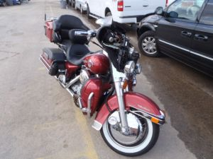 A salvage Harley Davidson on a Copart lot.