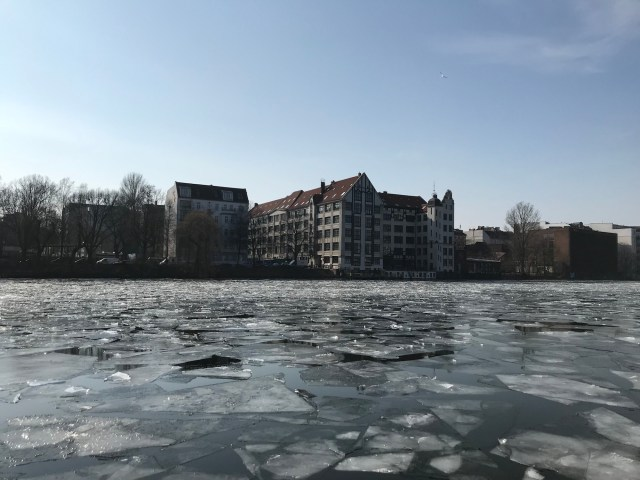 A photo of the Spree River frozen in Berlin during spring
