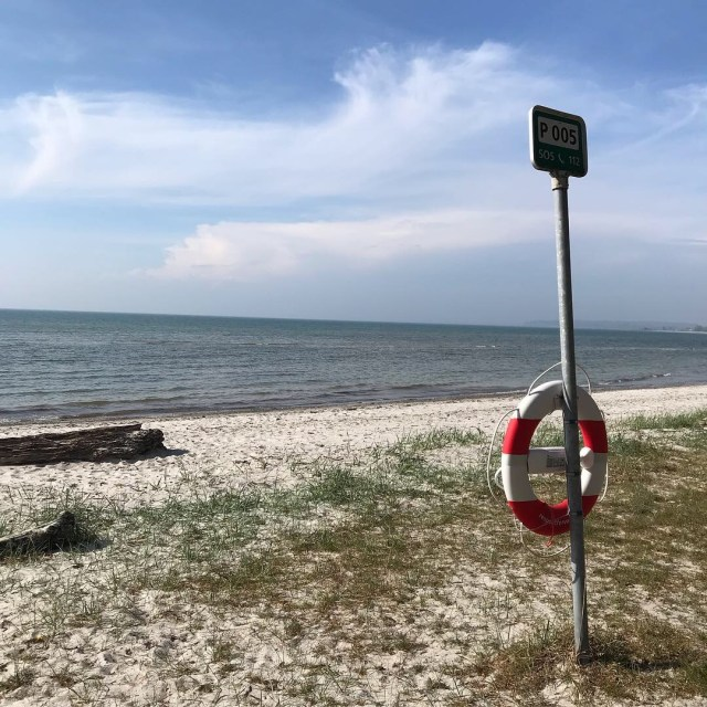 A picture of a beach with the SOS sign