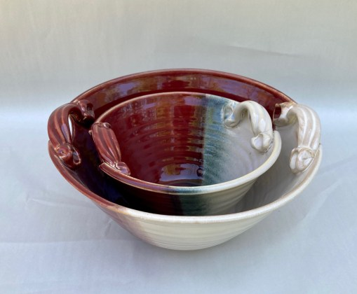 Handmade nested pottery bowls red