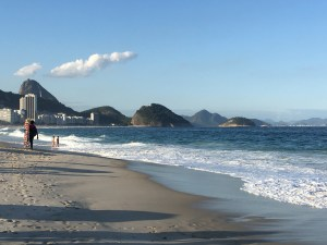 A hawker traipses down Copacabana beach, Rio de Janeiro, Brazil