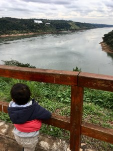 My toddler looking out over Brazil and Paraguay from the Three Frontiers, Argentina
