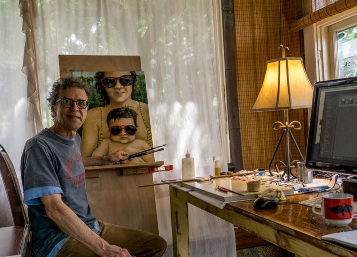Picture of Sam painting a portrait of Lulu and Penny on Maui