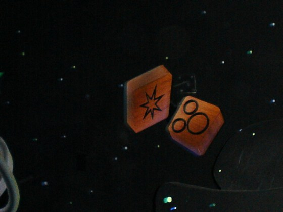 Find this Hidden Mickey on a tile in the first room of Buzz Lightyear's Astro Blasters