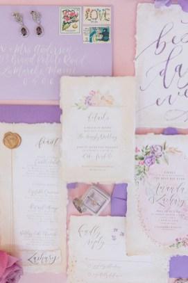 Sam Allen Creates - Rapunzel Inspired Wedding Invitation with Watercolor Flowers on Handmade Paper - Invitation Flatlay - Photo by Jess Palatucci