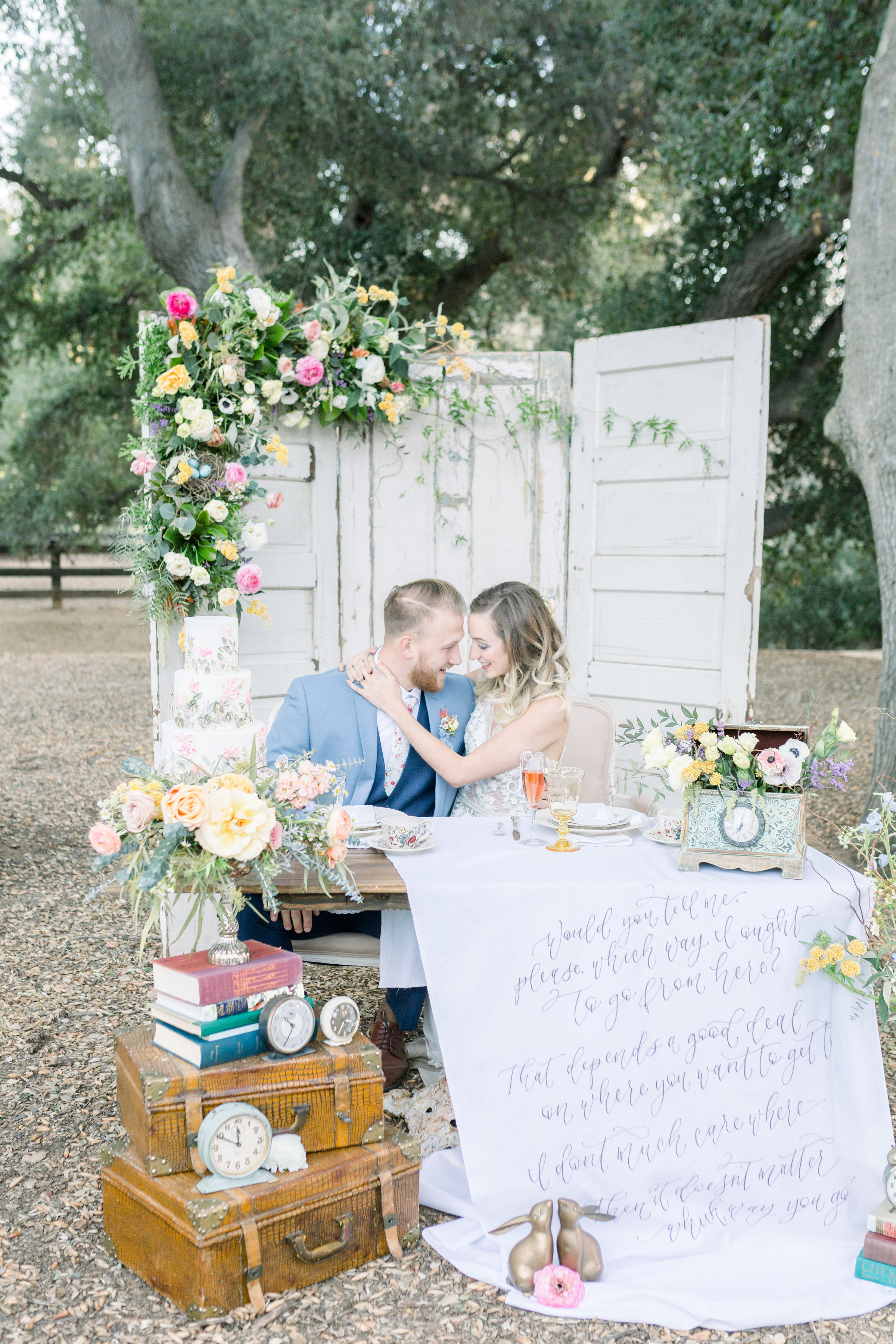 StephanieWeberPhotography-Alice-in-Wonderland-garden-wedding-reception-decor-sweetheart-table-with-fabric-sign-quote