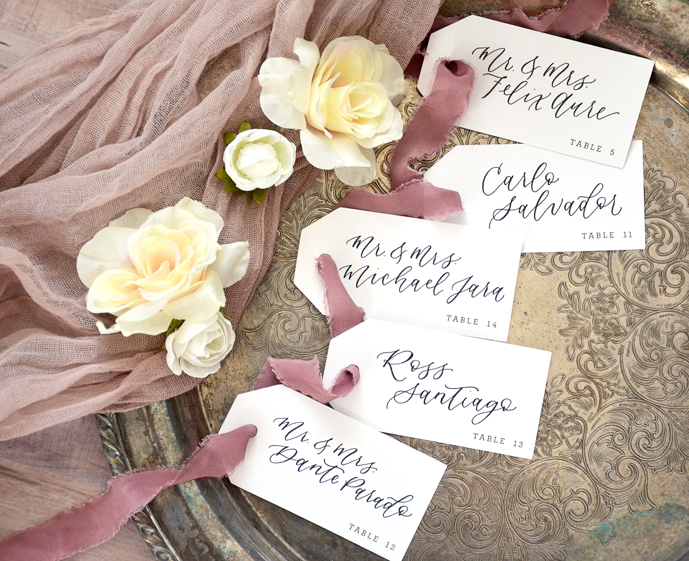 Sam Allen Creates Wedding Calligraphy Escort Name Tags with Table Numbers