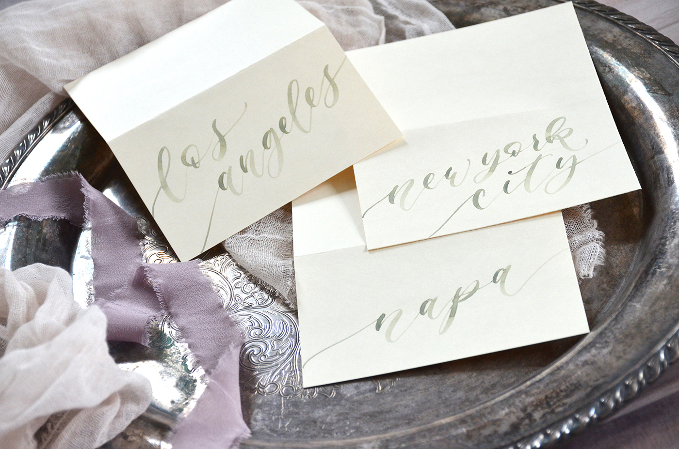 Sage Green Watercolor City Tent Cards for Wedding Centerpiece Table Names and Numbers by YourNewFriendSam on Etsy.jpg
