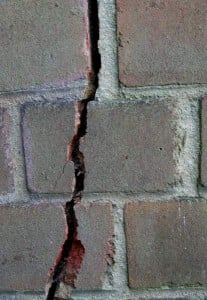 Foundation repair, retaining wall crack because of foundation settling