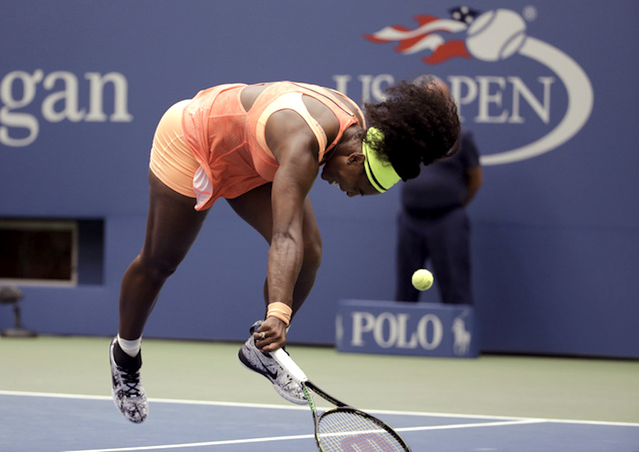 Serena Williams stumbles as she fails to catch up with a drop shot from Roberta Vinci, of Italy, during a semifinal match at the U.S. Open tennis tournament, Friday, Sept. 11, 2015, in New York. (AP Photo/David Goldman)