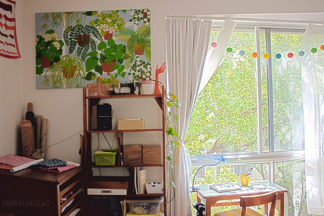 plant fabric stretched over canvas for wall art in sewing room
