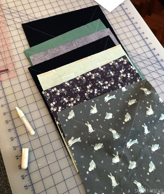 navy and mint triangle baby quilt fabric stacks