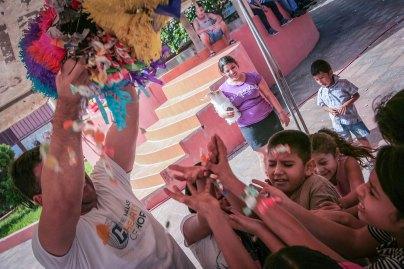 Candy raining from piñata
