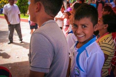 Soccer-loving boy under the piñata tent